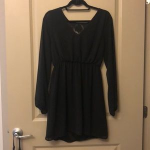 Long sleeve black dress with lace detail